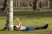 UNITED KINGDOM, London: 26 February 2019. A woman enjoys reading her book in the sunshine in Hyde Park on what is set to be the warmest day in February since records began. Temperatures are set to reach up to 20 degrees Celsius in the capital today. Rick Findler / Story Picture Agency