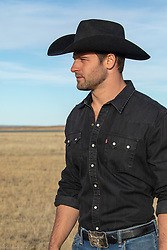 profile of a handsome cowboy outdoors