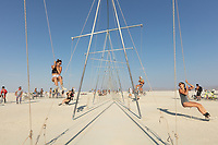 Burners playing on swings that are also seesaws. My Burning Man 2018 Photos:<br />