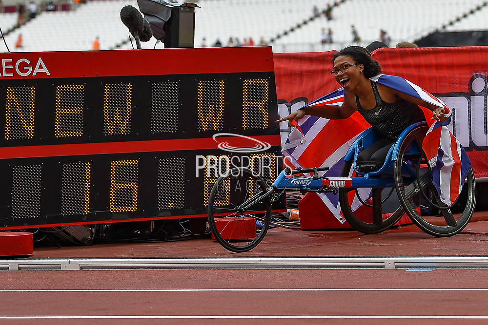 Kare Adenegan of Great Britain with her flag points to her new World Record on the timing board after winning the T34 Women's 100m at the Muller Anniversary Games, Day Two, at the London Stadium, London, England on 22 July 2018. Picture by Martin Cole.