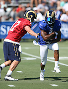 Los Angeles Rams wide receiver Tavon Austin (11) takes a handoff from Los Angeles Rams quarterback Case Keenum (17) during the Los Angeles Rams 2016 NFL training camp football practice held on Tuesday, Aug. 2, 2016 in Irvine, Calif. (©Paul Anthony Spinelli)