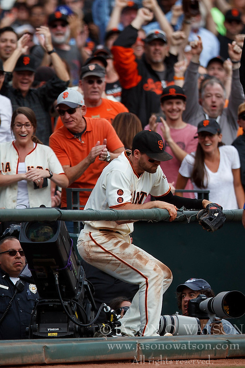 SAN FRANCISCO, CA - OCTOBER 02: Conor Gillaspie #21 of the San Francisco Giants climbs out of a photo well after catching a foul ball hit off the bat of Chase Utley (not pictured) of the Los Angeles Dodgers during the third inning at AT&T Park on October 2, 2016 in San Francisco, California. The San Francisco Giants defeated the Los Angeles Dodgers 7-1. (Photo by Jason O. Watson/Getty Images) *** Local Caption *** Conor Gillaspie