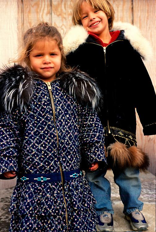 Barrow, Alaska. Siblins Juliana (2) and James Aikins (5) in their parkas. MR