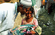 With his grand-daughter, Abdul Matleb (55) is playing with his new born grandson, Muhammad Hassan outside to his makeshift camp at the outskirts of Delhi State of India. More than 10,000-numbers of Burmese Rohingya Muslim refugee took shelter in Indian (Hyderabad) Andhra Pradesh, (Mewat) Haryana, (Kanchankunj) Delhi and Jammu States after ethnic strife between Rohingya Muslims and Buddhists that had been started since 1940s. Still so many peoples of aforesaid community have been living at various refugee camps in Myanmar, Bangladesh and India chiefly. Rohingya Muslims of Buthidaung, Rathedaung and Sittwe of Rakhine (formerly, Arakan) State, who ran away from Myanmar (that is, Burma) to Bangladesh to India and others South-Asian countries to escape socio-political-religious violence. (Photo/Shib Shankar Chatterjee)