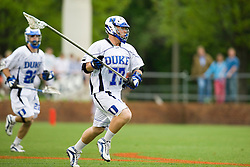Duke defenseman Nick O'Hara (77) clears the ball against UVA.  The #2 ranked Duke Blue Devils defeated the #3 ranked Virginia Cavaliers 11-9 in the finals of the Men's 2008 Atlantic Coast Conference tournament at the University of Virginia's Klockner Stadium in Charlottesville, VA on April 27, 2008.