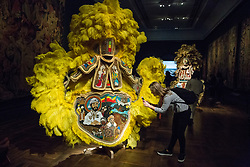 London, UK. 13 September, 2019. Big Chief Demond Melancon of the Young Seminole Hunters + Assemble's Black Masking Culture in the Tapestries Gallery at the Victoria & Albert museum for the London Design Festival comprises Melancon's huge Mardi Gras Indian suits composed of intricately hand-sewn beadwork. His work draws from a broad variety of stylistic influences, addresses stereotypical representations of black people, and tells powerful stories from his experience of the African diaspora.