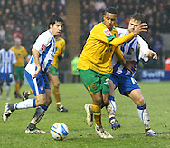 Colchester - Saturday January 16th, 2010:  Korey Smith of Norwich and David Fox of Colchester in action during the Coca Cola League One match at the Weston Homes Community Stadium, Colchester. (Pic by Paul Chesterton/Focus Images).