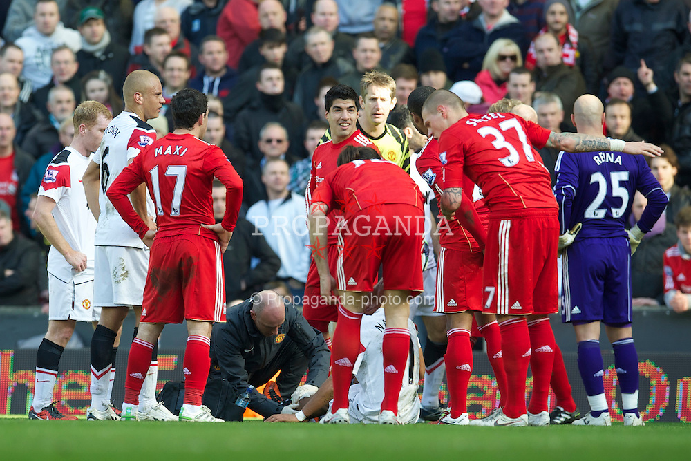 LIVERPOOL, ENGLAND - Sunday, March 6, 2011: Manchester United's Nani is treated for a gash to his shin after a challenge by Liverpool's Jamie Carragher, amazingly the player was not wearing any protective shin pads, during the Premiership match at Anfield. (Photo by David Rawcliffe/Propaganda)