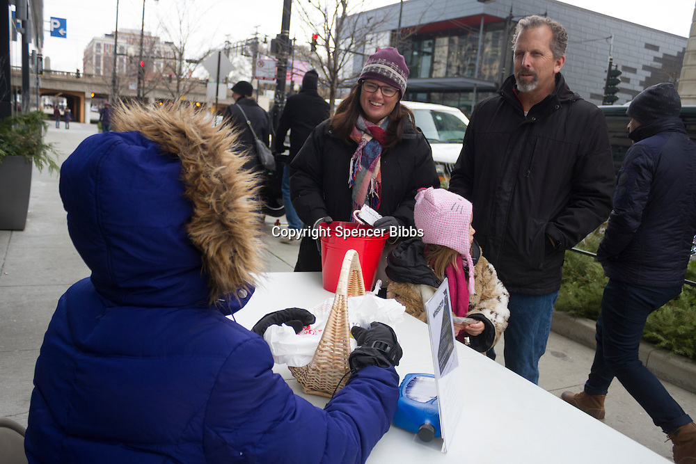 "Neighborhood volunteers spoke with people on 53rd Street Saturday afternoon about the Whistle Stop program. The Whistle Stop program is a safety and security program that Hyde Parker's are bringing back to the neighborhood.<br /> <br /> 8754, 8748 – LaKeisha Hamilton speaks with Aimee, Ella and Rand Tucker about the Whistle Stop Program.<br /> <br /> Please 'Like' ""Spencer Bibbs Photography"" on Facebook.<br /> <br /> All rights to this photo are owned by Spencer Bibbs of Spencer Bibbs Photography and may only be used in any way shape or form, whole or in part with written permission by the owner of the photo, Spencer Bibbs.<br /> <br /> For all of your photography needs, please contact Spencer Bibbs at 773-895-4744. I can also be reached in the following ways:<br /> <br /> Website – www.spbdigitalconcepts.photoshelter.com<br /> <br /> Text - Text ""Spencer Bibbs"" to 72727<br /> <br /> Email – spencerbibbsphotography@yahoo.com"