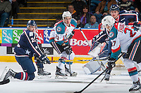 KELOWNA, CANADA - MARCH 4: Dakota Krebs #2 of the Tri-City Americans tries to block a shot by Calvin Thurkauf #27 to Reid Gardiner #23 of the Kelowna Rockets on March 4, 2017 at Prospera Place in Kelowna, British Columbia, Canada.  (Photo by Marissa Baecker/Shoot the Breeze)  *** Local Caption ***