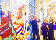 Garden City, New York, USA. March 9, 2019.  L-R, artist MICHAEL WHITE, Hempstead Town Supervisor LAURA GILLEN, and Nassau County Legislator DEBRA MULÉ are talking with each other next to White's mural, after Unveiling Ceremony of the mural of Nunley's Carousel horse. Event was held at historic Nunley's Carousel in its Pavilion on Museum Row on Long Island. After speeches by elected officials and members of Baldwin Civic Association and Baldwin Historical Society, and others, people enjoy free carousel rides and food.