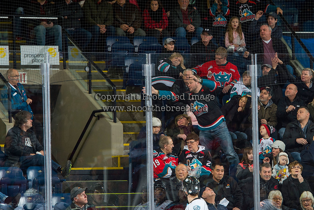 KELOWNA, CANADA - DECEMBER 2: Paul Mondoux tries to catch a stray puck in the stands against the Kootenay Ice on December 2, 2017 at Prospera Place in Kelowna, British Columbia, Canada.  (Photo by Marissa Baecker/Shoot the Breeze)  *** Local Caption ***