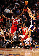 Jan. 6 2010; Phoenix, AZ, USA; Phoenix Suns guard (13) Steve Nash puts up a shot against the Houston Rockets guard (0) Aaron Brooks in the first half at the US Airways Center. Mandatory Credit: Jennifer Stewart-US PRESSWIRE