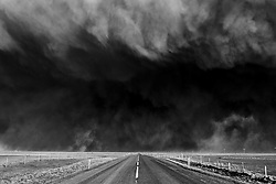 Volcanic eruption, Eyjafjallajokull, Iceland. The highway and dark volcanic ash clouds
