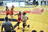 """Mississippi Lady Rebels forward Danielle McCray (22) drives against Georgia Bulldogs forward Krista Donald (15) at the C.M. """"Tad"""" Smith Coliseum in Oxford, Miss. on Thursday, January 15, 2015.  (AP Photo/Oxford Eagle, Bruce Newman)"""