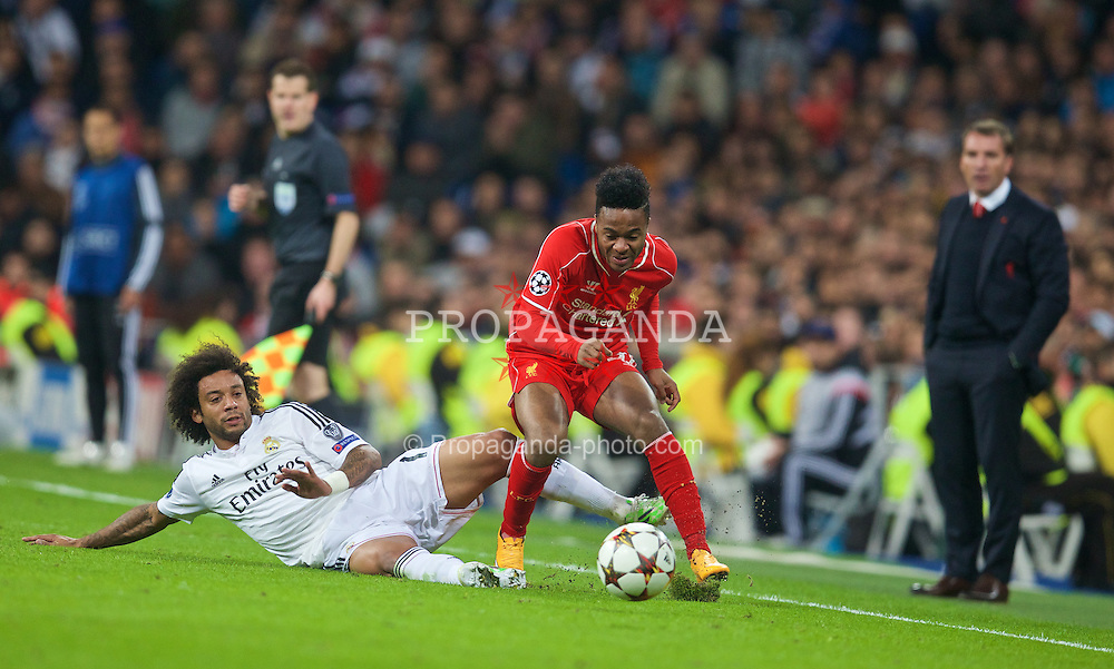 MADRID, SPAIN - Tuesday, November 4, 2014: Liverpool's Raheem Sterling is fouled by Real Madrid's Marcelo during the UEFA Champions League Group B match at the Estadio Santiago Bernabeu. (Pic by David Rawcliffe/Propaganda)