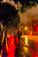 Couple walking on a rainy evening, Powell Street, San Francisco, California USA