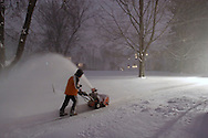 Middletown, NY - A man uses a snowblower to clear snow from a driveway during a winter storm on Dec. 19, 2008.
