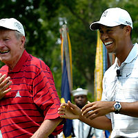 04 July 2007:  Former President George H. W. Bush (L) and Tiger Woods (R) share a laugh after Bush teed off to start the inaugural AT&T National PGA event at Congressional Country Club in Bethesda, Md. The proceeds of the golf tournament will benefit the Tiger Woods Foundation and local Washington, DC, based charities.   ****For Editorial Use Only