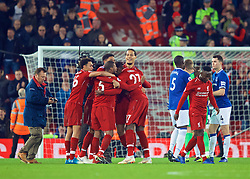 LIVERPOOL, ENGLAND - Sunday, December 2, 2018: Liverpool players celebrate after a dramatic late injury time winning goal from Divock Origi as Everton's goalkeeper Jordan Pickford is consoled after his mistake during the FA Premier League match between Liverpool FC and Everton FC at Anfield, the 232nd Merseyside Derby. Liverpool won 1-0. (Pic by Paul Greenwood/Propaganda)
