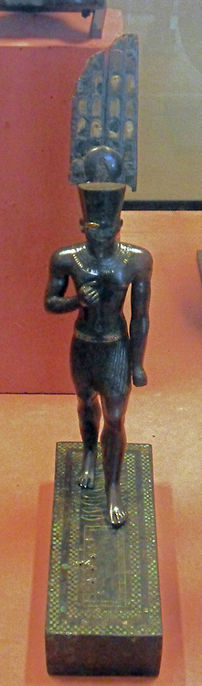 The god Amun 25-26 Dynastic? 715-525 BC. Black and bronze inlaid plate