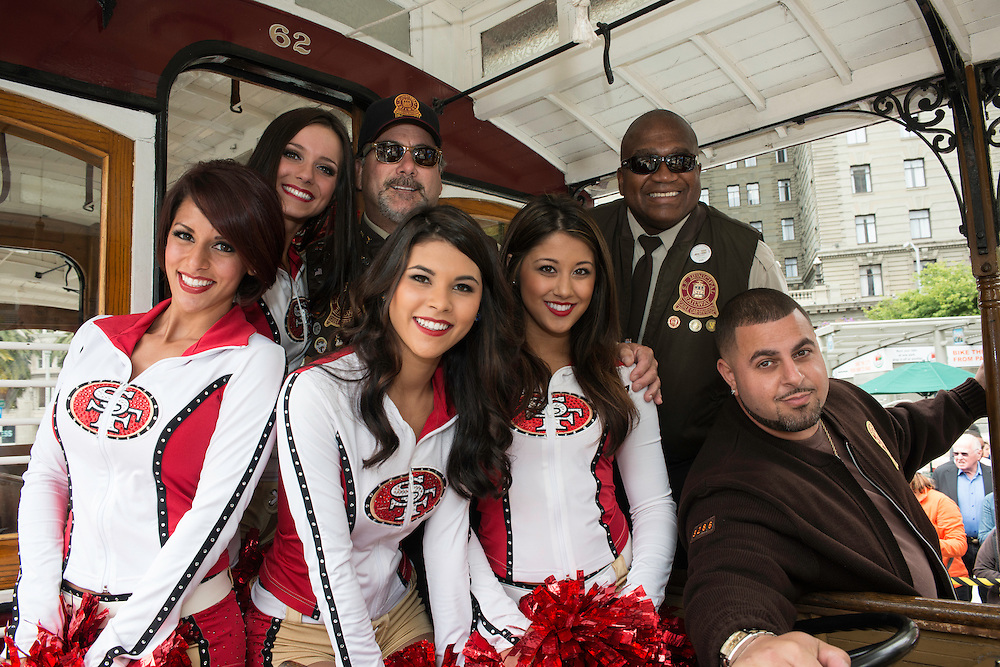 The 49ers Gold Rush cheerleaders pose with bell ringing participants Ken Lunardi, Leonard Oats, and Jorge Lacayo at the 50th Cable Car Bell Ringing Competition in San Francisco's Union Square | July 11, 2013