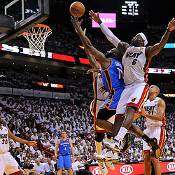 Jun 17, 2012; Miam, FL, USA; Oklahoma City Thunder guard James Harden (13) shoots over Miami Heat small forward LeBron James (6) during the first quarter in game three in the 2012 NBA Finals at the American Airlines Arena. Mandatory Credit: Derick E. Hingle-US PRESSWIRE