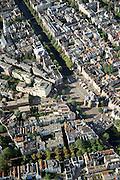 Nederland, Amsterdam, Nieuwmarkt, 25-09-2002; Kloveniersburgwal (diagonaal vanaf linksboven met bomen), naar Nieuwmarkt met Waag; linksboven Zuiderkerk, rechtsboven begin van de Wallen, de Nieuwbouw tussen de historische gebouwen (linksonder Recht Boomssloot) is gebouwd na de sloop voor de aanleg metro; stadsplein, binnenstad, monumenten, bebouwing, stadsgezicht, vogelvlucht;  .zie ook andere (detail)foto's rond deze lokatie;<br /> luchtfoto (toeslag), aerial photo (additional fee)<br /> foto /photo Siebe Swart