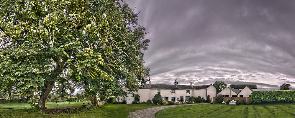 Panoramic of an old Georgian style country farmhouse in the Lake District, Cumbria.