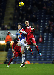 Bristol City's Greg Cunningham battles for the high ball with Blackburn Rovers' Ruben Rochina - Photo mandatory by-line: Joe Meredith/JMP  - Tel: Mobile:07966 386802 05/01/2013 - Blackburn Rovers v Bristol City - SPORT - FOOTBALL - FA Cup -  BLACKBURN - EWOOD PARK -