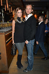 AMBER LE BON and DAN KAPP at the launch of Korean restaurant Jinjuu with chef Judy Joo at 15 Kingley Street, London on 22nd January 2015.