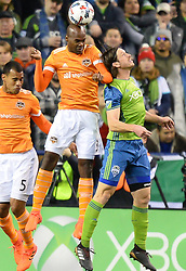 November 30, 2017 - Seattle, Washington, U.S - Soccer 2017: ADOLFO MACHADO (3) and GUSTAV SVENSSON (4) in action as the Houston Dynamo play the Seattle Sounders in the 2nd leg of the MLS Western Conference Finals match at Century Link Field in Seattle, WA. (Credit Image: © Jeff Halstead via ZUMA Wire)