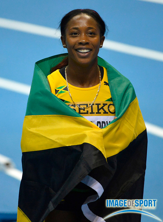 Mar 9, 2014; Sopot, Poland; Shelly-Ann Fraser-Pryce (JAM) takes a victory lap after winning the womens 60m in 6.98 in the IAAF World Indoor Championships in Athletics at Ergo Arena.