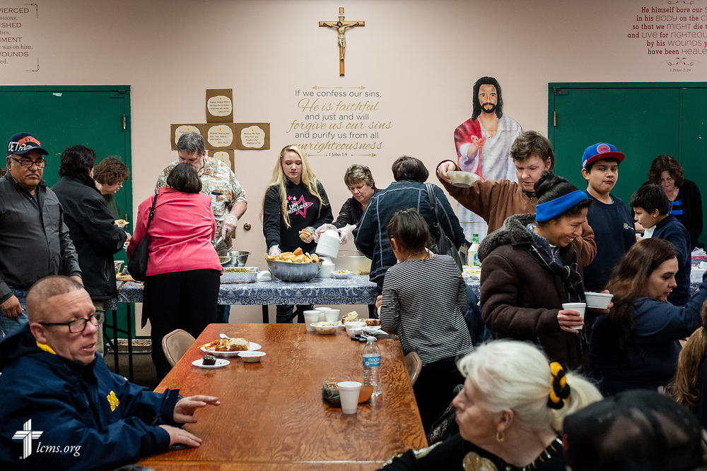 Volunteers distribute food for the daily dinner meal at Family of God on Wednesday, March 28, 2018, in Detroit. LCMS Communications/Erik M. Lunsford