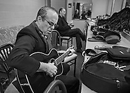 Tom Russell practicing in the Green room at Sisters High School before a Winter Concert Series performance.  2011
