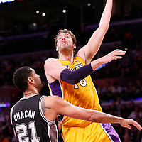 19 March 2014: Los Angeles Lakers center Pau Gasol (16) goes for the skyhook over San Antonio Spurs forward Tim Duncan (21) during the San Antonio Spurs 125-109 victory over the Los Angeles Lakers at the Staples Center, Los Angeles, California, USA.