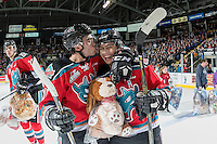 KELOWNA, CANADA - DECEMBER 3: Rodney Southam #17 and Nick Merkley #10 of the Kelowna Rockets celebrate a second period goal triggering the annual teddy bear toss against the Brandon Wheat Kings on December 3, 2016 at Prospera Place in Kelowna, British Columbia, Canada.  (Photo by Marissa Baecker/Shoot the Breeze)  *** Local Caption ***
