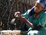 Sorse Likasa serves up some freshly roasted and ground Ethiopian coffee, Kotoba, Ethiopia.