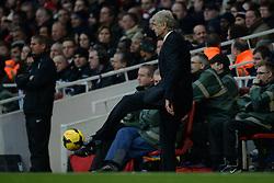 Arsenal Manager, Arsene Wenger kicks the ball - Photo mandatory by-line: Mitchell Gunn/JMP - Tel: Mobile: 07966 386802 23/11/2013 - SPORT - Football - London - Emirates Stadium - Arsenal v Southampton - Barclays Premier League