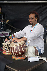 Man playing a tabla on stage at the WOMAD (World of Music; Arts and Dance) Festival in reading; 2005,