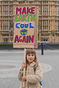 Mimi Travis aged 8 (a climate protest veteran, apparently) during speeches at Old Palace Yard - Trump & May Climate Disaster protest in support of the US climate march today. As Trump reaches his first 100 days and pushes to slash the US climate research budget. In the UK the government has been reducing budgets and appears to be veering away from Climate Act commitments by forcing through a 3rd runway at Heathrow.