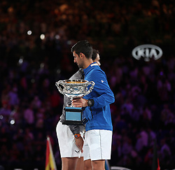 MELBOURNE, Jan. 27, 2019  Novak Djokovic (R) of Serbia and Rafael Nadal of Spain react during the trophy awarding ceremony after the men's singles final match at 2019 Australian Open in Melbourne, Australia, Jan. 27, 2019. (Credit Image: © Bai Xuefei/Xinhua via ZUMA Wire)