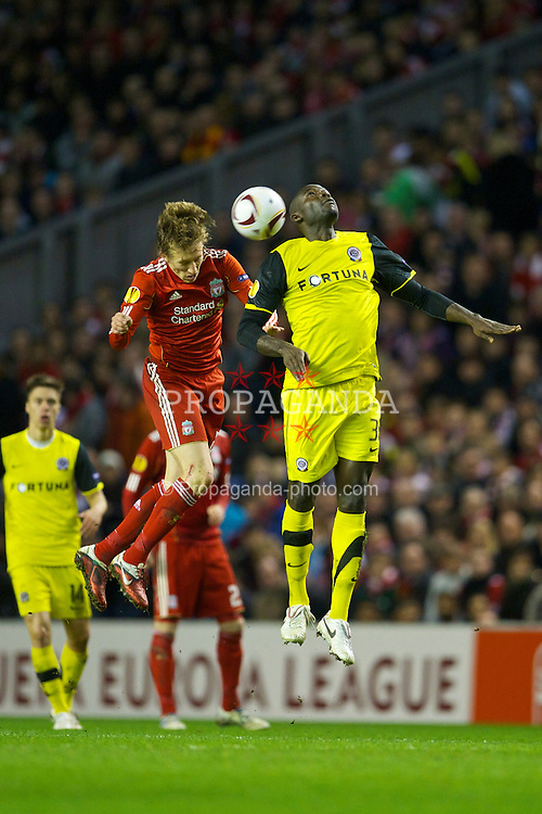 LIVERPOOL, ENGLAND, Thursday, February 24, 2011: Liverpool's Lucas Leiva and AC Sparta Praha's Martin Achille Abena Biholong during the UEFA Europa League Round of 32 2nd leg match at Anfield. (Photo by David Rawcliffe/Propaganda)