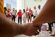 15 JULY 2010 - PHOENIX, AZ: Members of the Tea Party and supporters of SB 1070 join hands in prayer in front of the courthouse Thursday. People for and against SB 1070 picketed the front of the Sandra Day O'Connor US Courthouse (CQ) in Phoenix Thursday morning during the first hearing against SB 1070.  PHOTO BY JACK KURTZ