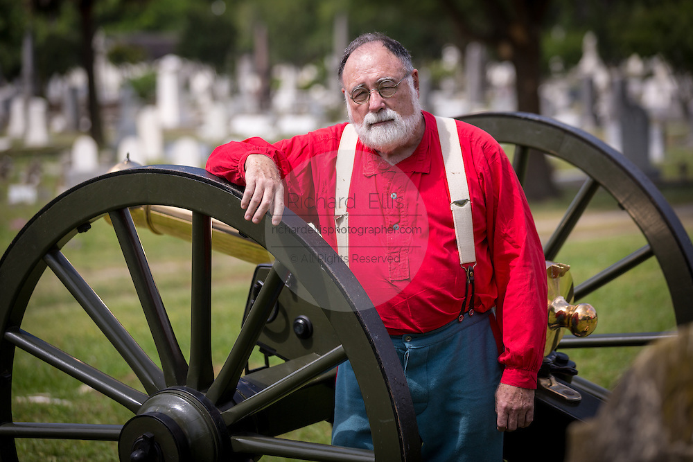 A Civil War re-enactor poses with a cannon during Confederate Memorial Day at Magnolia Cemetery April 10, 2014 in Charleston, SC.