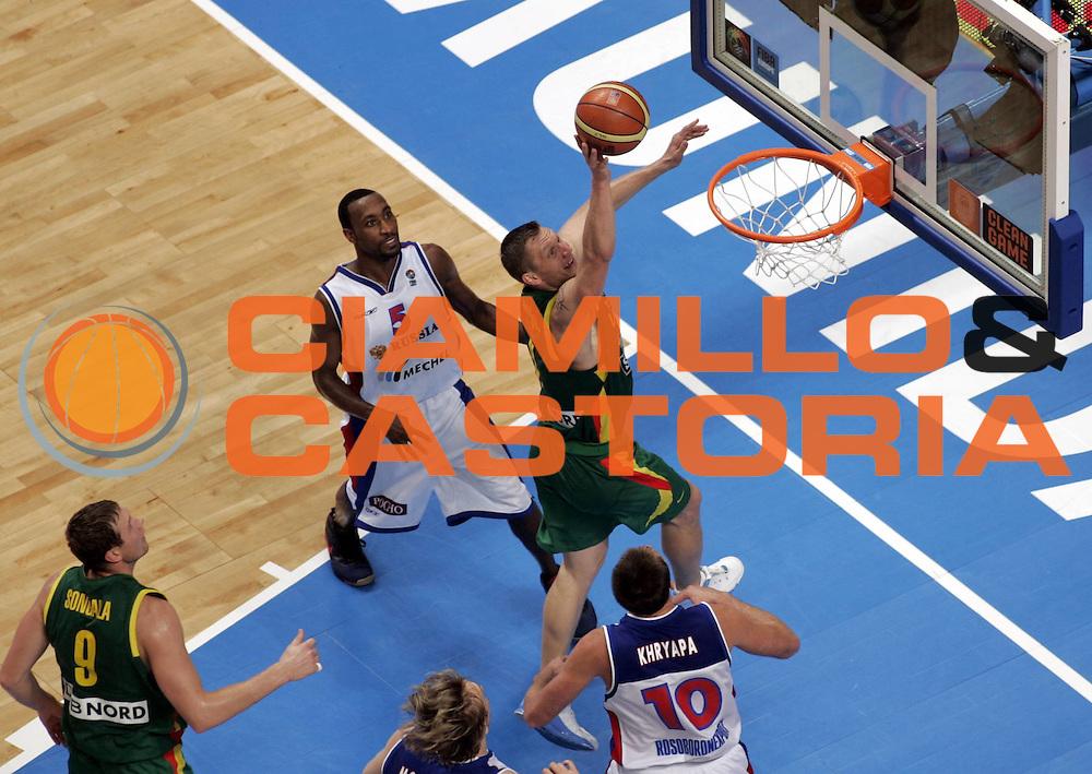 DESCRIZIONE : Madrid Spagna Spain Eurobasket Men 2007 Semi Finals Semifinali Russia Lituania Russia Lithuania <br /> GIOCATORE : Rimantas Kaukenas<br /> SQUADRA : Lituania Lithuania<br /> EVENTO : Eurobasket Men 2007 Campionati Europei Uomini 2007 <br /> GARA : Russia Lituania Russia Lithuania<br /> DATA : 15/09/2007 <br /> CATEGORIA : Tiro<br /> SPORT : Pallacanestro <br /> AUTORE : Ciamillo&amp;Castoria/H.Bellenger<br /> Galleria : Eurobasket Men 2007 <br /> Fotonotizia : Madrid Spagna Spain Eurobasket Men 2007 Semi Finals Semifinali Russia Lituania Russia Lithuania <br /> Predefinita :
