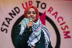 London, UK. 16th March, 2019. Heena Khaled addresses thousands of people on the March Against Racism demonstration on UN Anti-Racism Day against a background of increasing far-right activism around the world and a terror attack yesterday on two mosques in New Zealand by a far-right extremist which left 49 people dead and another 48 injured.