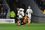 Hull City midfielder Markus Henriksen (22) and Leeds United striker Kemar Roofe (7) during the EFL Sky Bet Championship match between Hull City and Leeds United at the KCOM Stadium, Kingston upon Hull, England on 30 January 2018. Photo by Ian Lyall.