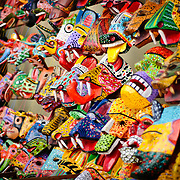 Colorful wooden masks for sale at Chichi's market. Chichicastenango is an indigenous Maya town in the Guatemalan highlands about 90 miles northwest of Guatemala City and at an elevation of nearly 6,500 feet. It is most famous for its markets on Sundays and Thursdays.