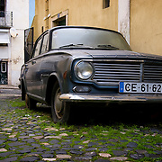 Old car in the streets of the Alfama district of Lisbon